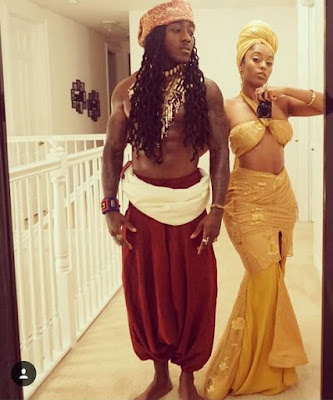 American rapper AceHood and his girlfriend Sheila  Halloween Costume as Sango, God of Thunder and Osun, goddess of love and fertility.
