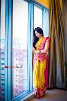 Actress Adah Sharma Exclusive Poshoot in Beautiful Yellow Silk Saree at Saree Niketan Showroom Launch  0005.jpg