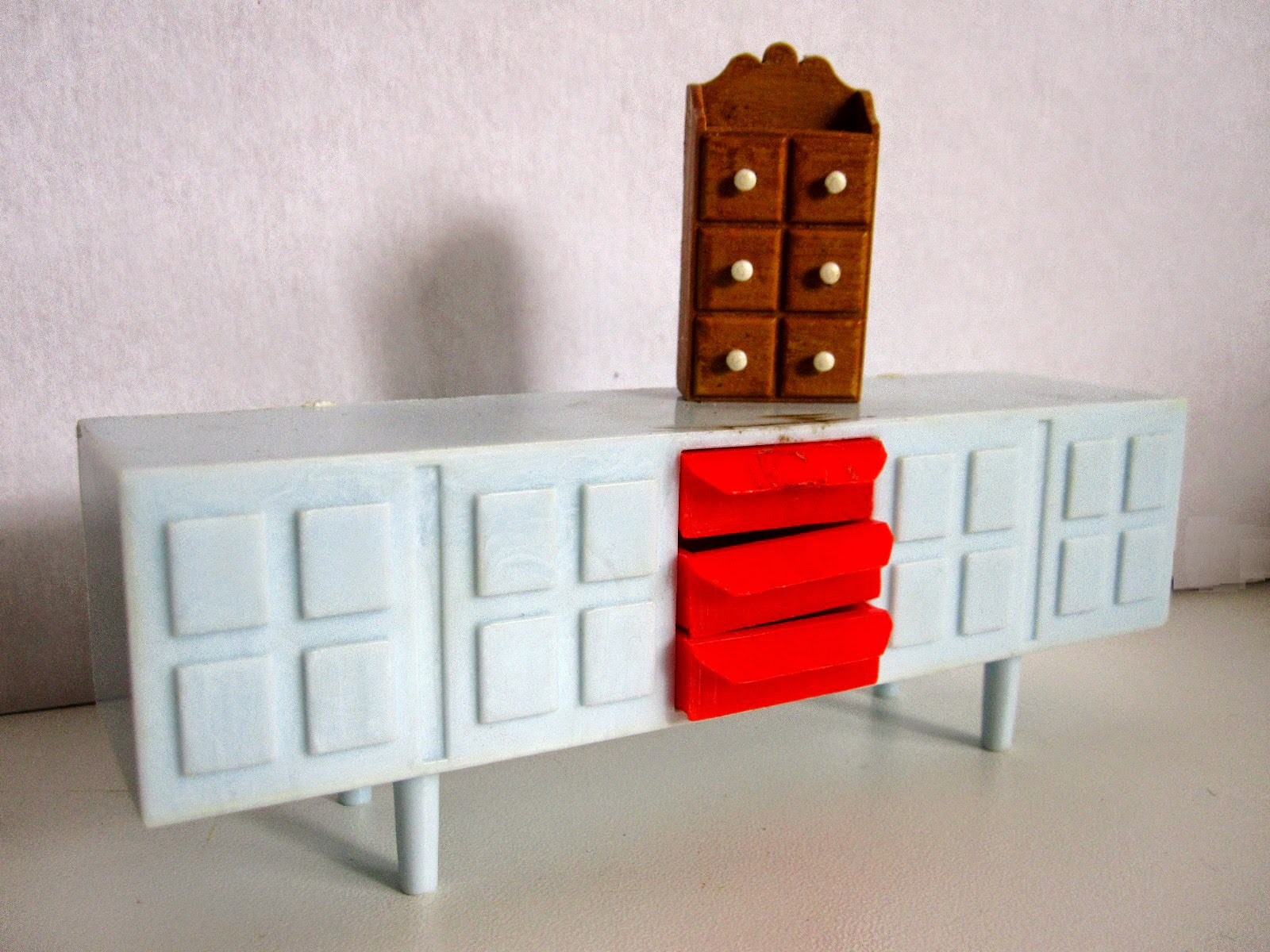 Modern dolls' house miniature plastic sideboard and spice cabinet.