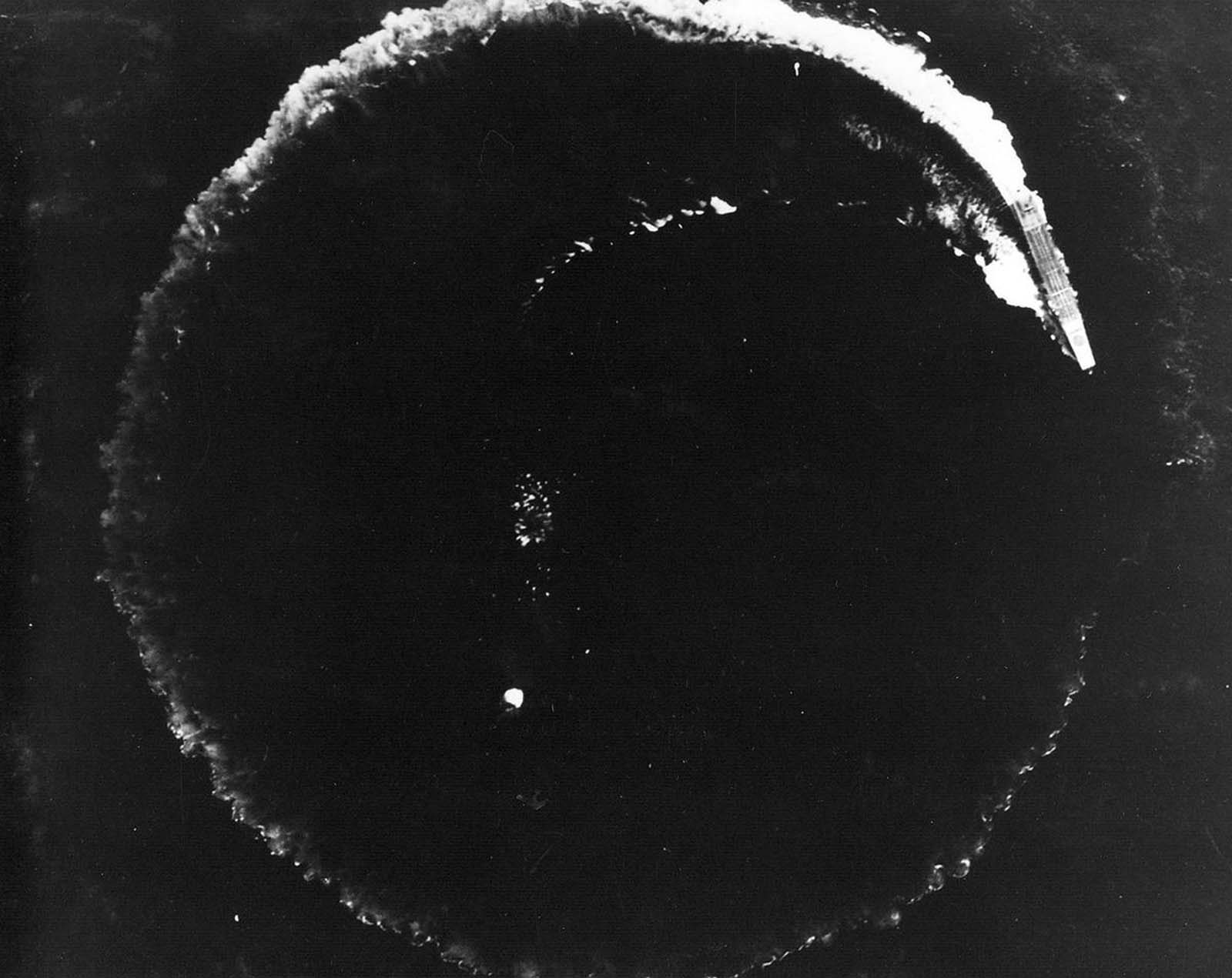 The Japanese aircraft carrier Soryu maneuvers to avoid bombs dropped by Army Air Forces B-17 Flying Fortresses during the Battle of Midway, on June 4, 1942.