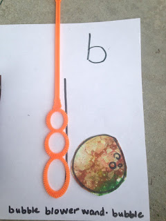 "Teach lower case letters ""b"" and ""d"" using bubble wand"