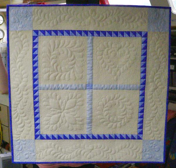 Quilt Feather free motion quilting