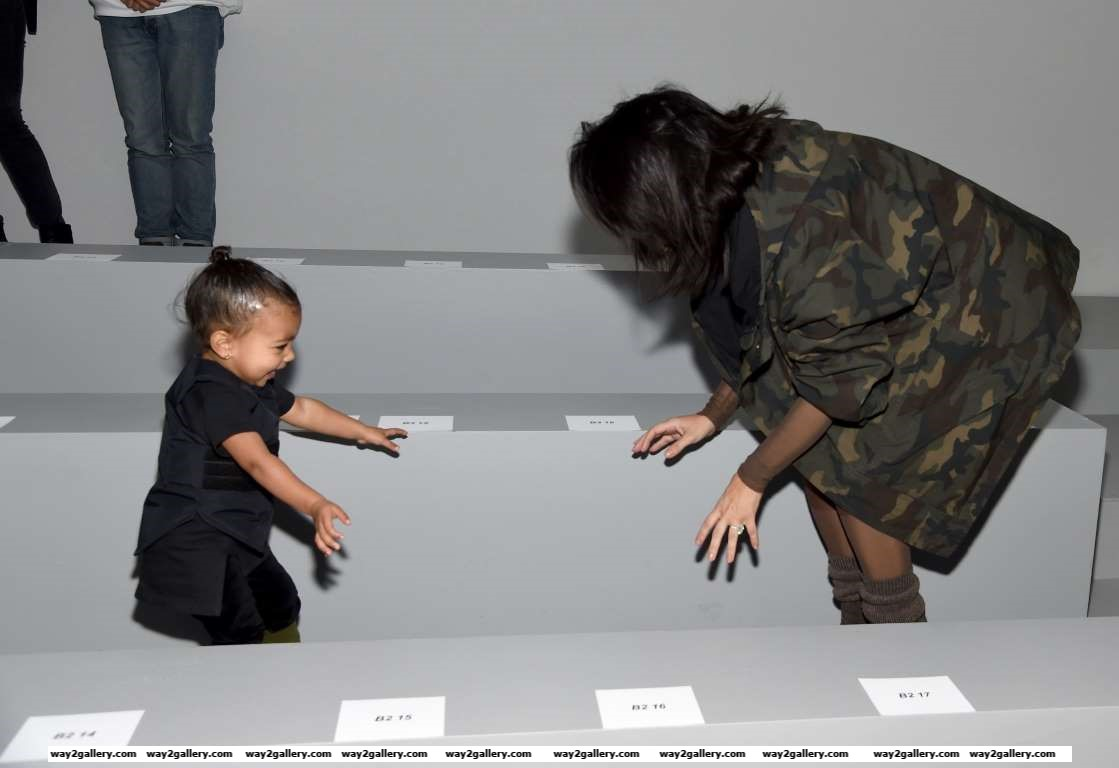 Kim Kardashian R and daughter North attend the adidas Originals x Kanye West YEEZY SEASON  fashion show at Skylight Clarkson Sq on February   in New York City