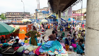 Sitting under the bridge and approach people in Lagos
