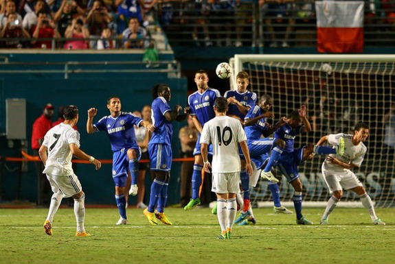 Real Madrid player Cristiano Ronaldo scores a goal against Chelsea from a free-kick