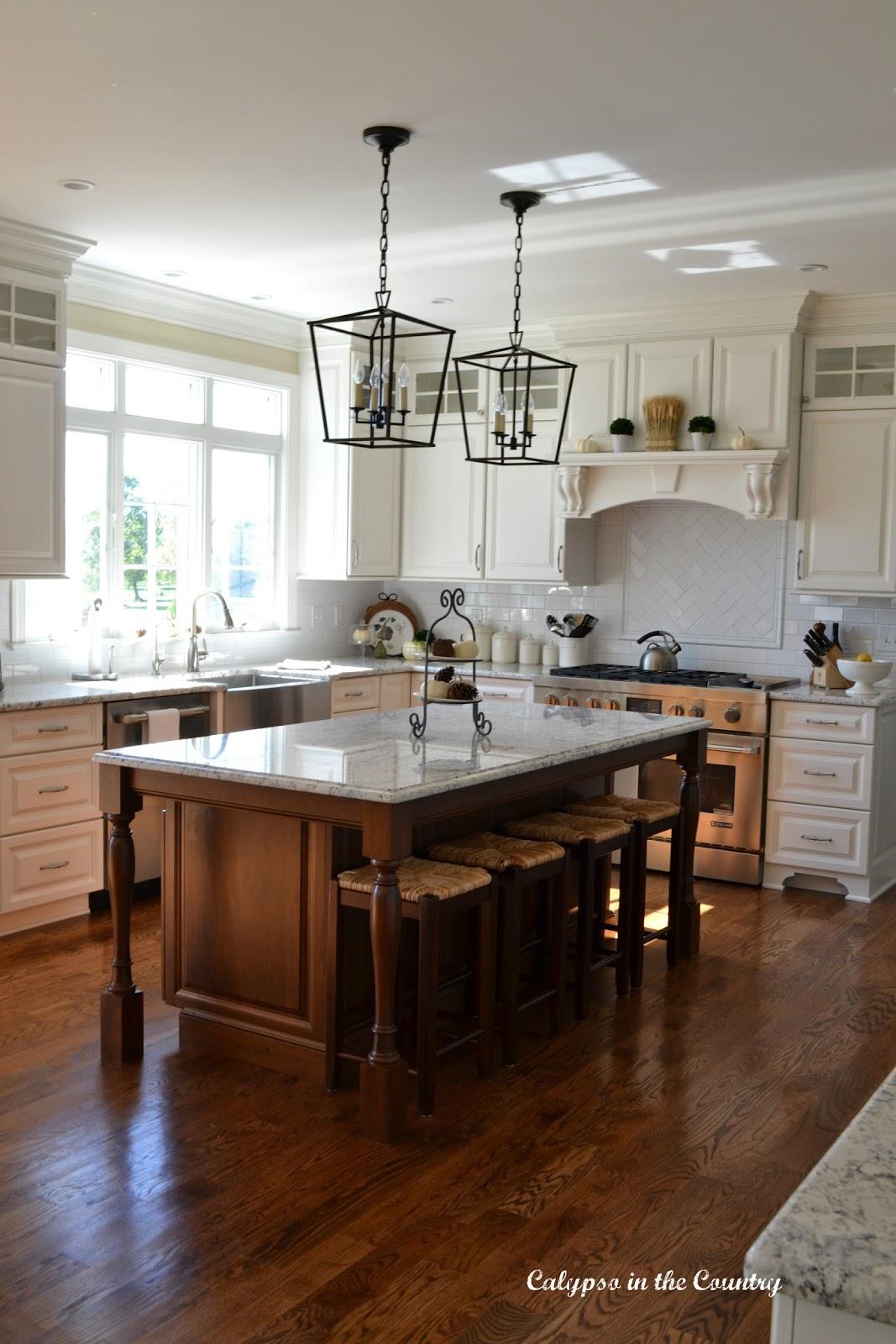 White Kitchen with Cherry Island and Rush Seat Stools