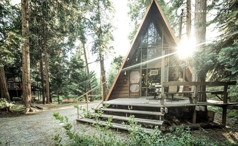 02-Front-Entrance-Glamping-Hub-A-Frame-House-Architecture-www-designstack-co