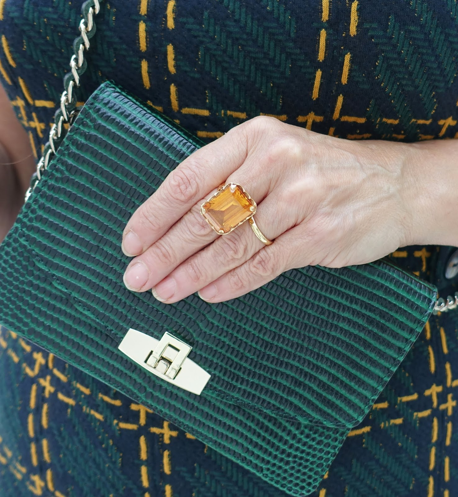 Citrine ring and green cross-the-body bag outfit detail