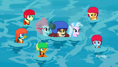 Ocellus (as a seapony) and Silverstream hold Yona in the centre as the others swim around them