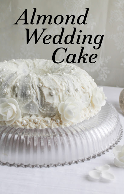 Food Lust People Love: A simple one-bowl batter is the base of this beautiful almond wedding cake, decorated with almond buttercream icing and pearl and flower flourishes.