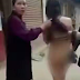 Angry Chinese wife catches her husband in the act with younger mistress and parades her naked on the streets