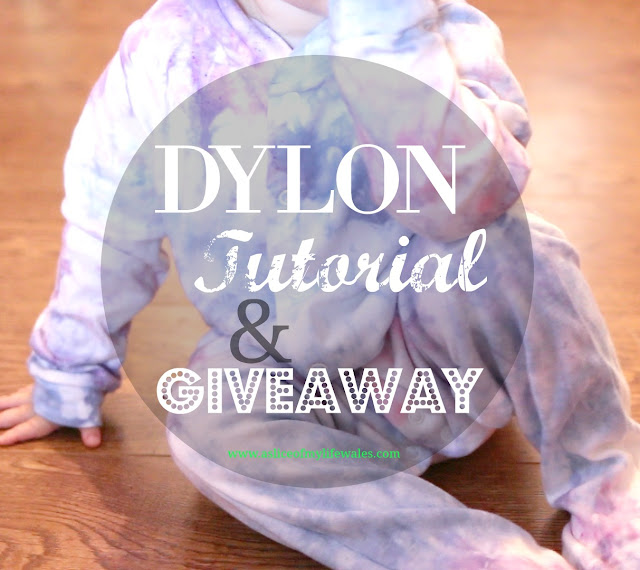 baby wearing a pink, purple and blue tie dye sleepsuit - video tutorial and a chance to win Dylon yourself