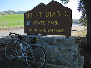 My bicycle at Mt. Diablo State Park North Gate entrance sign