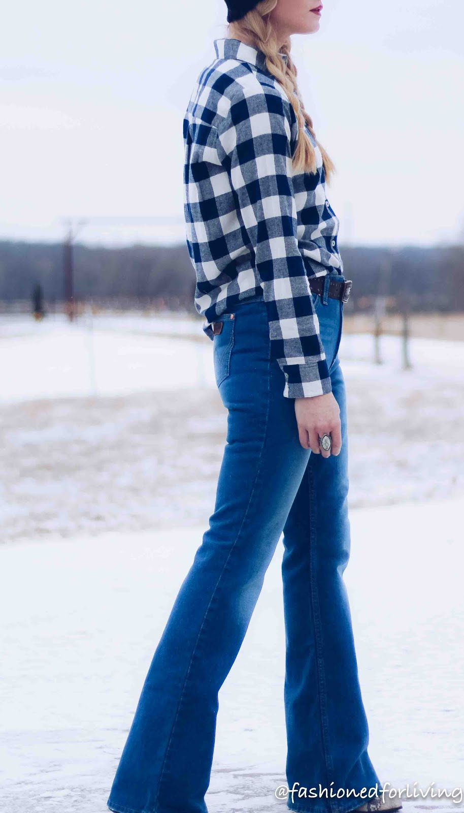womens winter flannel outfit with knit pom hat and flare jeans
