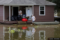 The downpours in Louisiana damaged 60,000 homes and tested scientists' ability to quickly determine climate change's role in the disaster. (Credit: Reuters) Click to Enlarge.