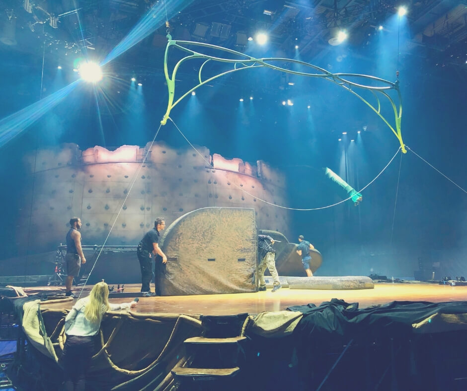 Technicians in the Cirque Du Soleil OVO crew get the stage ready for rehearsals.