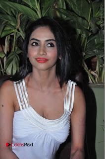 Actress Model Pooja Sri Stills in White Short Dress at F Club pre soft Launch  0078.JPG