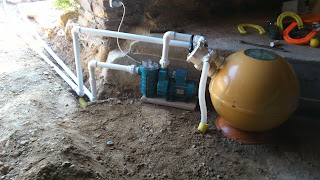 Completed pump and sand filter in the barn with the drainage pipe already buried