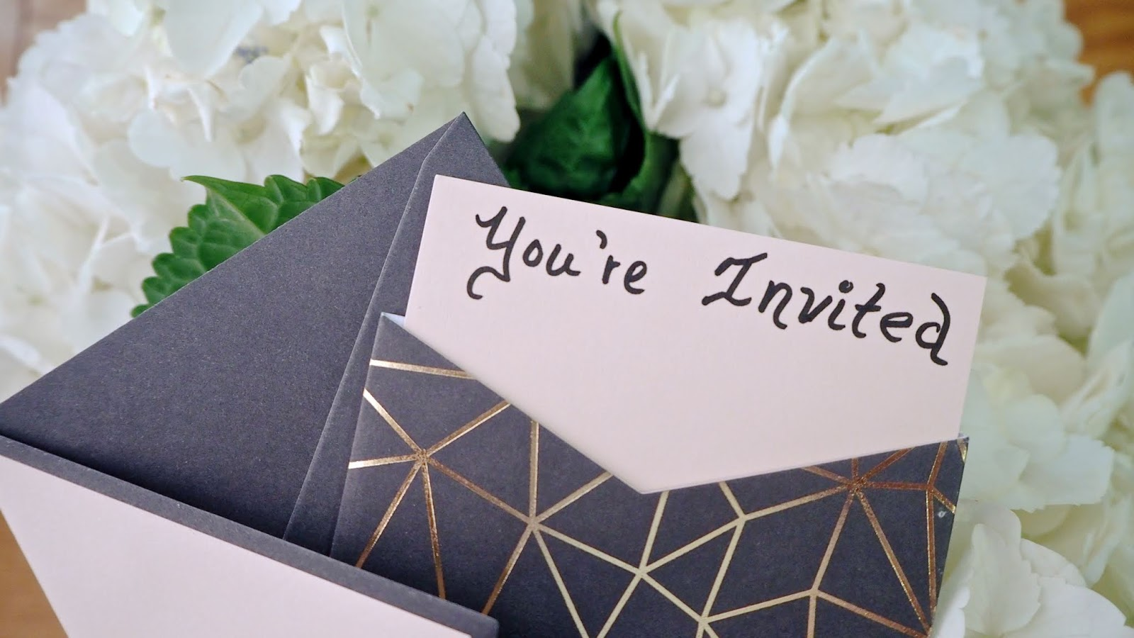 Invitation and white hydrangeas