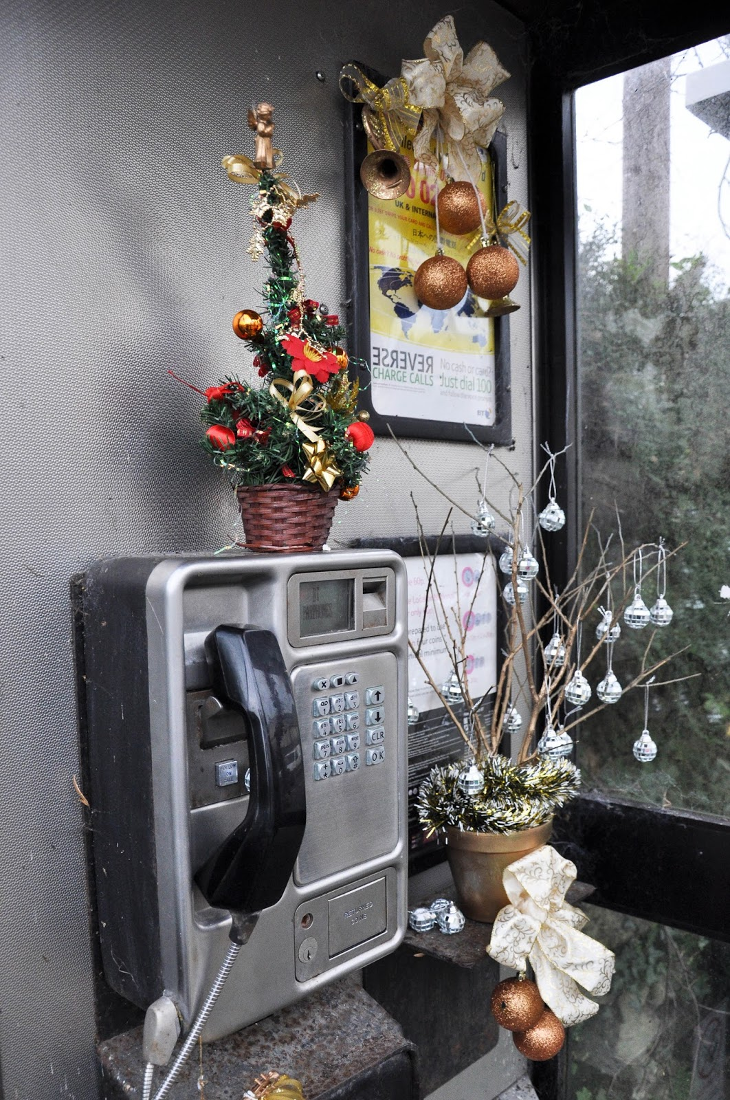 Telephone boot decorated for Christmas, Niton, Isle of Wight, England