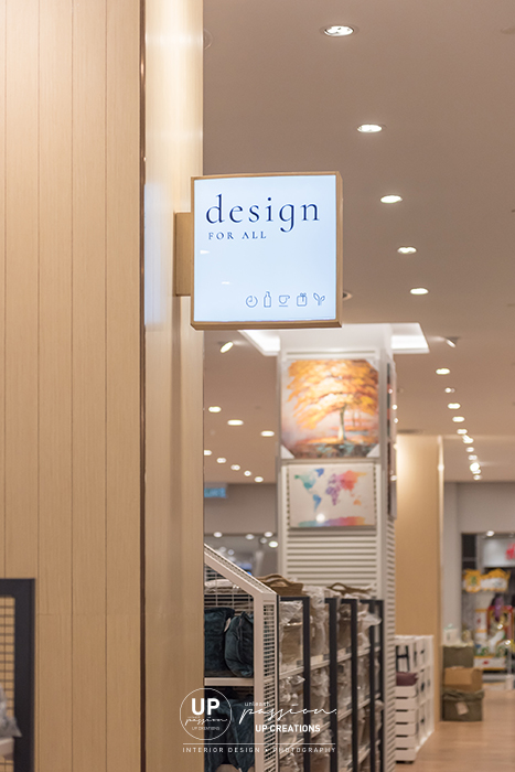 kaison aeon shah alam sign lightbox and column wrapped in wood veneer and bronze corner strip