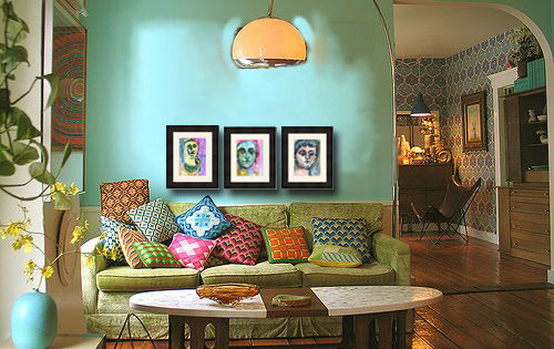 In This Bohemian Decorating Scheme Three Watercolors Grace The Wall Above A Sofa Adorned With Variety Of Patterns And Textures