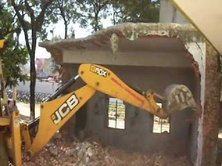 house-demolished-by-jcb