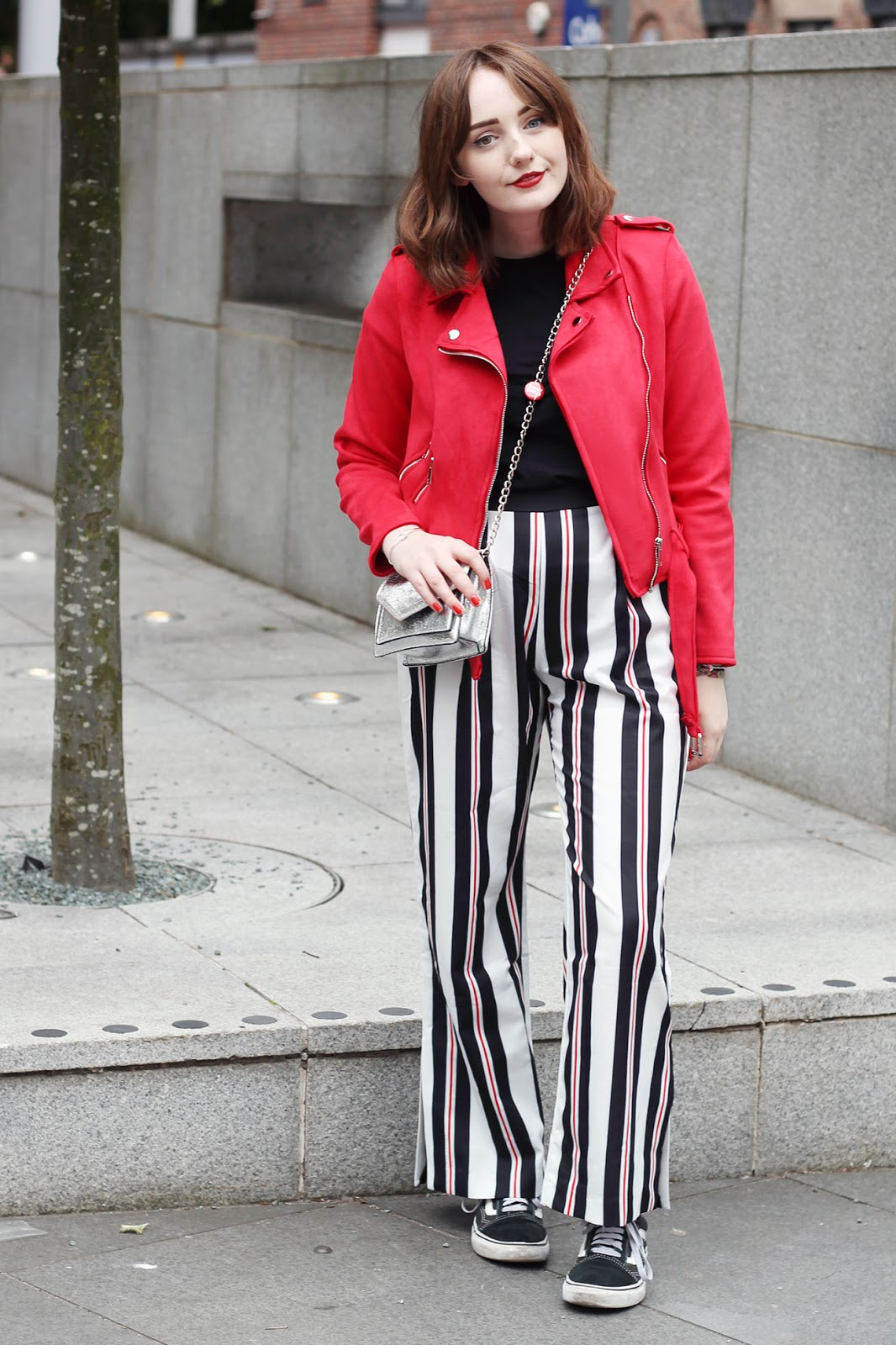 Liverpool style blogger Allie Davies wearing missy empire red biker jacket and striped trousers