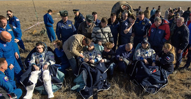 The crew of Soyuz MS-02 sits in couches after landing to undergo initial health checks. From left to right: NASA astronaut Shane Kimbrough, and Russian cosmonauts Sergey Ryzhikov and Andrey Borisenko. Photo Credit: Bill Ingalls / NASA