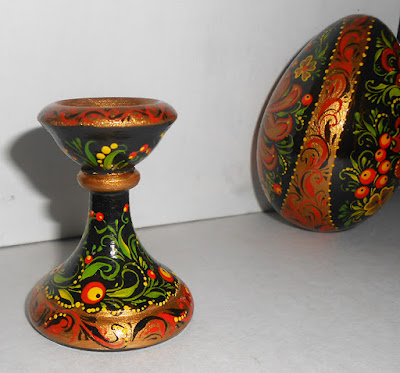 Easter egg on a pedestal with a Fierbird and flowers in Russian Khokhloma style in handmade