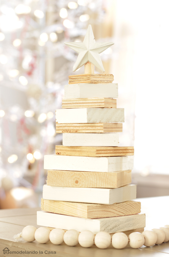 square pieces of wood stacked together to create a Christmas tree topped off with a star
