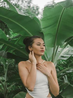 woman beside banana tree