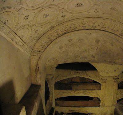 Floral stucco reliefs on the ceilings of the catacombs of San Sebastiano outside  of Rome, Italy.