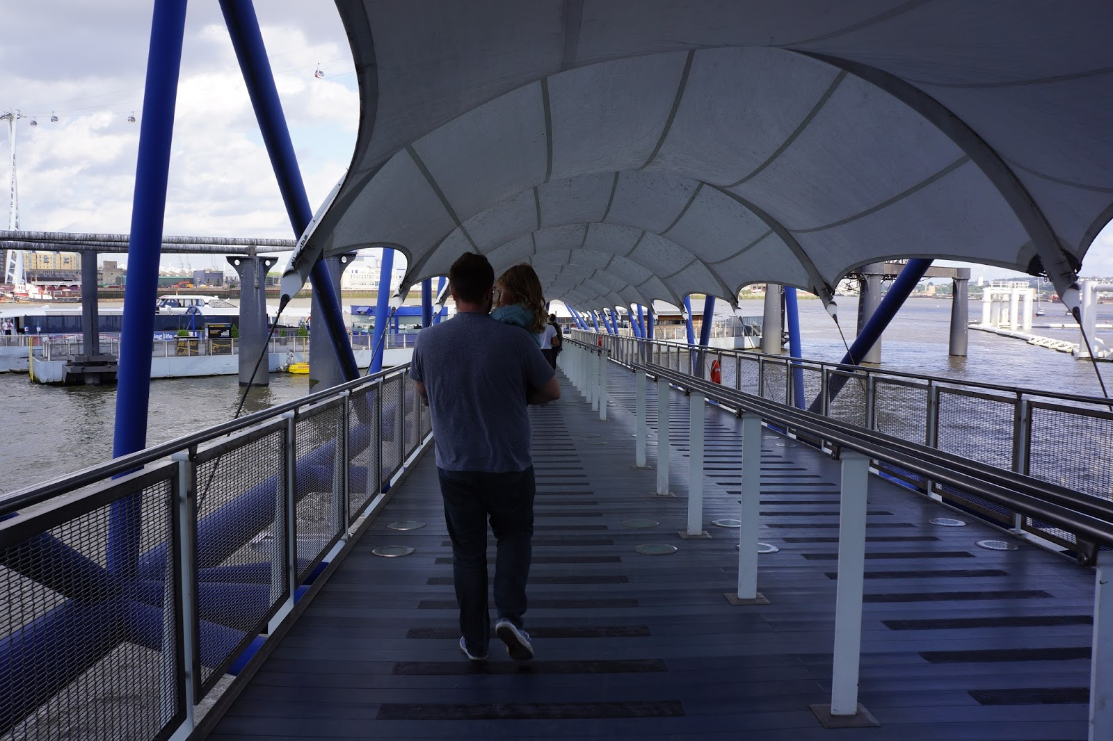 father and child walking at the mbna thames clippers pier at the o2