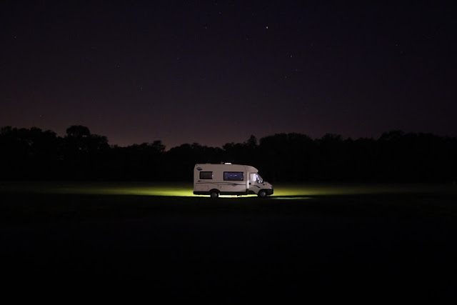 Motorhome lit up in the darkness
