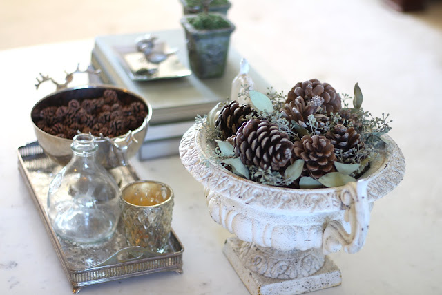 styling a coffee table pinecones antique urn fall christmas