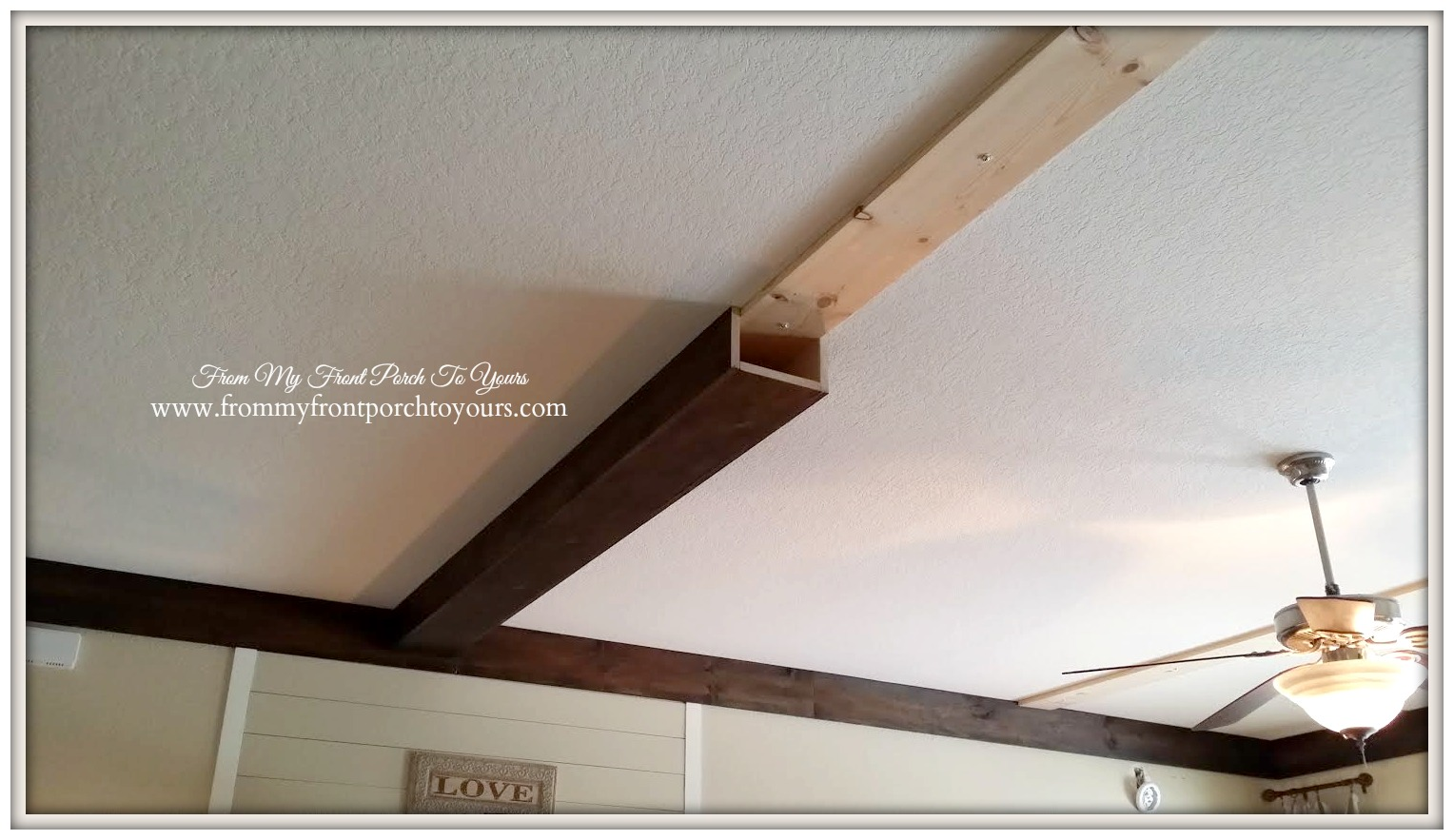 First beam installed onto living room ceiling at From My Front Porch To Yours.