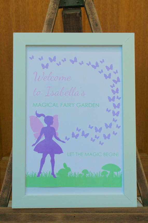 printable fairy party sign in frame on easle at door to welcome guests to fairy birthday