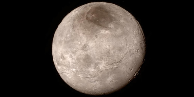 Charon, a moon of Pluto. When Charon is positioned between the sun and Pluto, Georgia Tech research indicates that the moon can significantly reduce atmospheric loss (image credit: NASA-JHUAPL-SwRI)