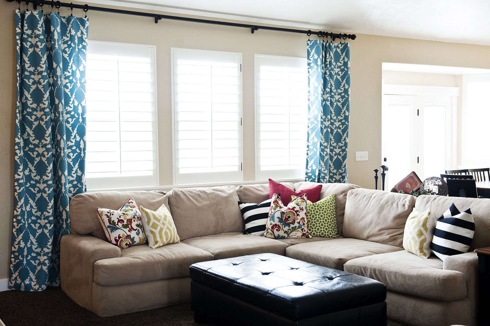 Client living room sprucing up house of jade interiors blog - Living room picture window treatments ...