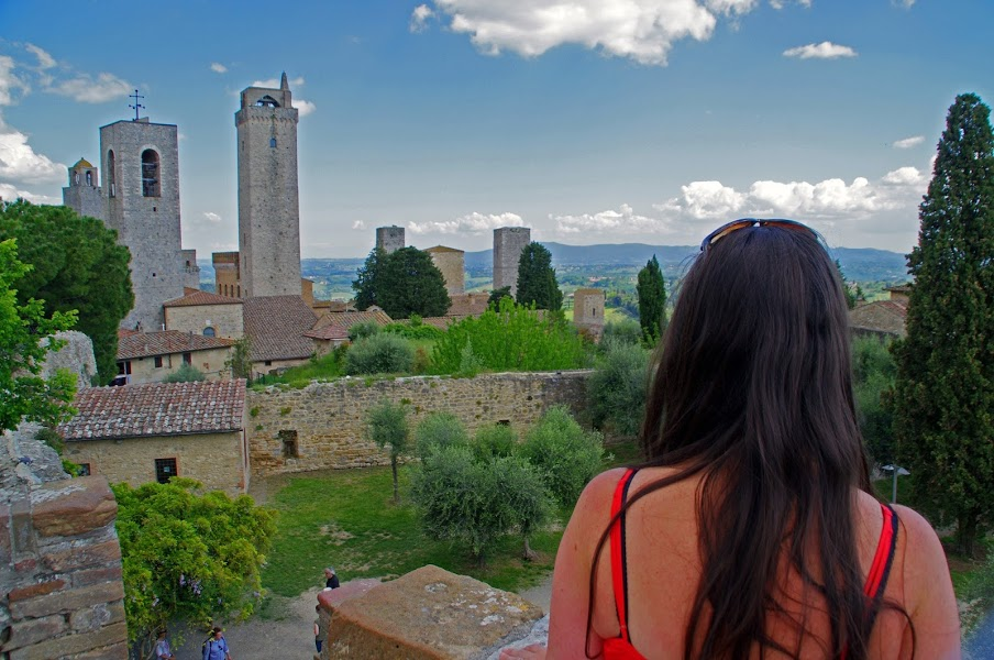 Girl overlooking towers of San Gimignano Tuscany Italy