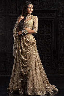 Golden color half sleeves Indian wedding outfit.