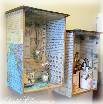 These vintage drawers covered in old book pages and maps add fun decor to the space.