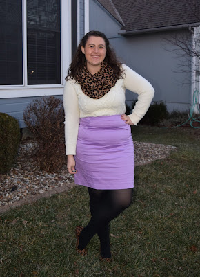 An outfit with a white sweater, lavender pencil skirt, leopard flats and leopard scarf