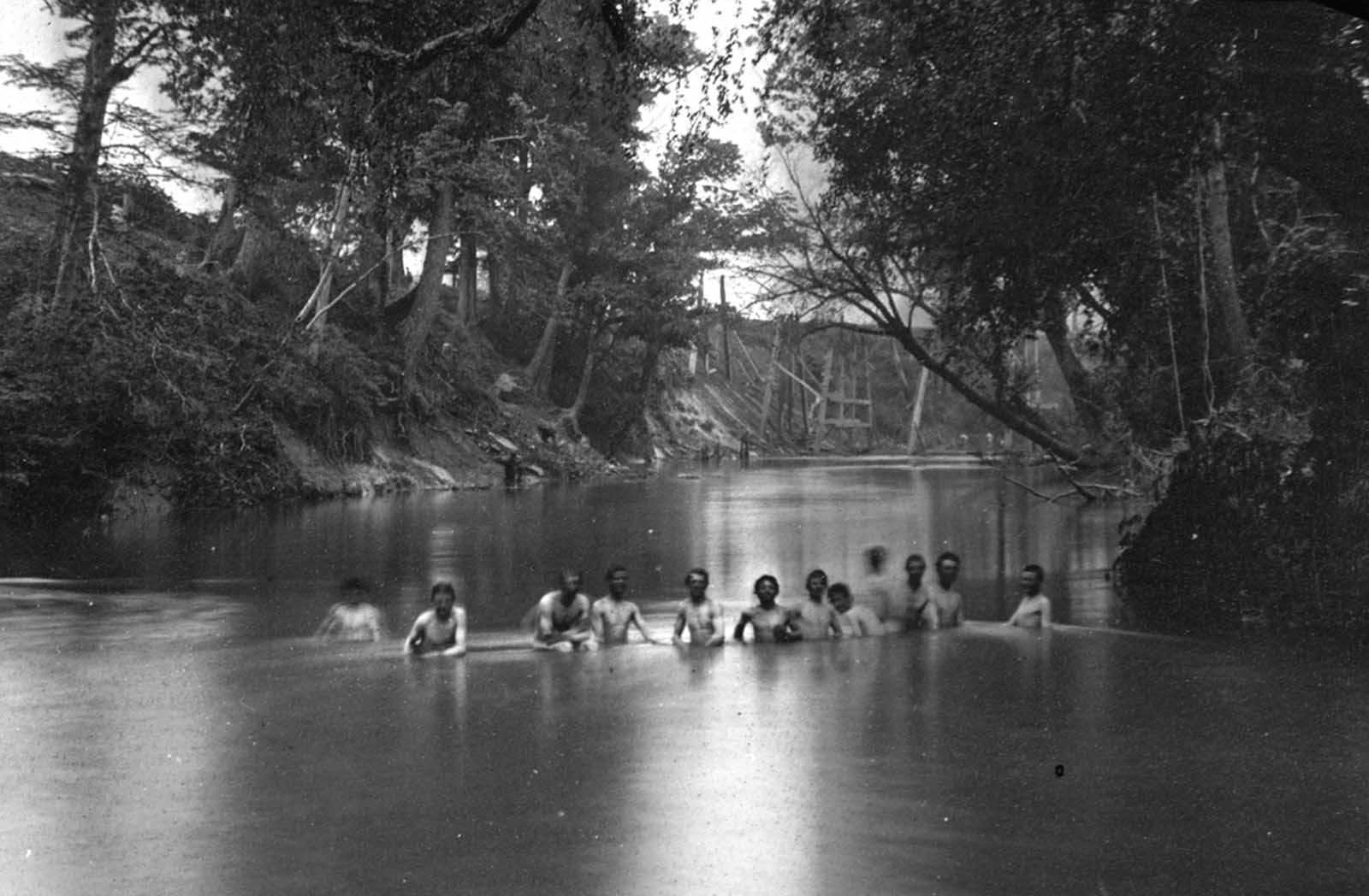 Soldiers bathing in the North Anna River, Virginia, in May of 1864. The ruins of Richmond & Fredericksburg railroad bridge are visible in the distance.