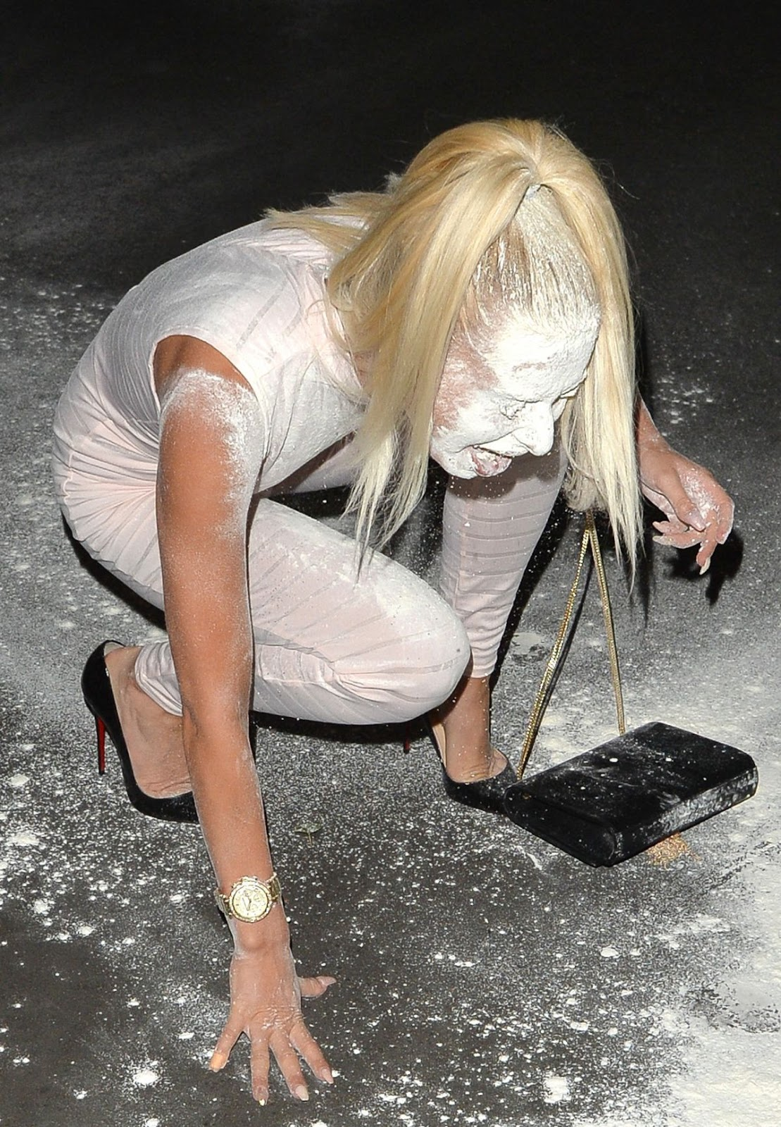 Ex On The Beach star Holly Rickwood getting Flour Bombed Leaving a Pub in west London