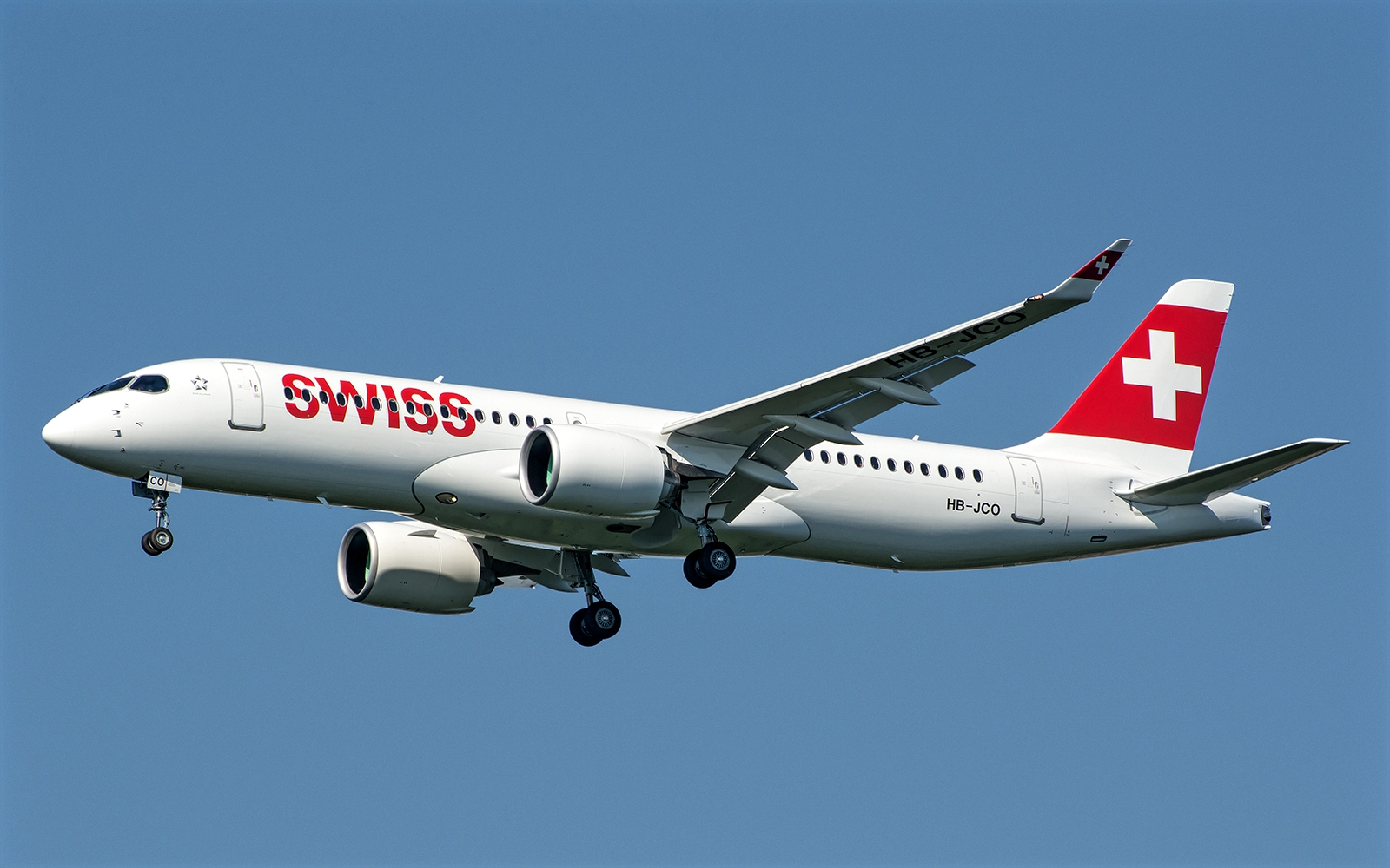 Airbus A220-300 of Swiss Air HB-JCO Retracting Landing Gear