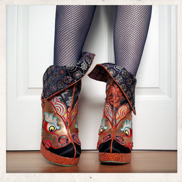 front view of Irregular Choice Tatsu ankle boots cuff half up