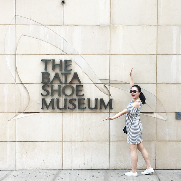 Posing next to the Bata Shoe Museum sign