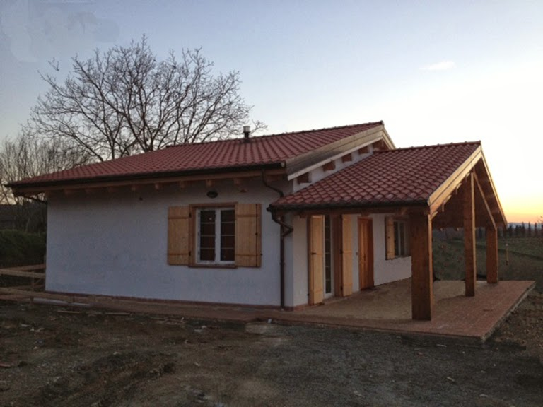Progetti di case in legno casa 95 mq portico 35 mq for Progetti interni case